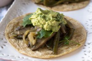 Baby portobella mushrooms and poblano pepper are marinated in a citrus marinate. Serve these fajitas with tortillas and a big scoop of guacamole.