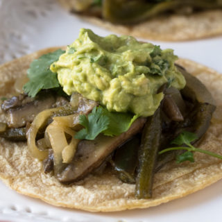 Baby portobella mushrooms and poblano pepper are marinated in a citrus marinate. Serve these fajitas with tortillas and a big scoop of guacamole.