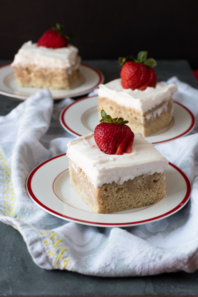 Vegan Tres Leches Cake topped with a light coconut whipped cream. Perfect for Cinco de Mayo or your next fiesta!