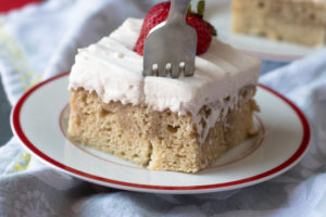 Vegan Tres Leches Cake is make with 3 different plant milks and topped with coconut whipped cream. Perfect for Cinco de Mayo!