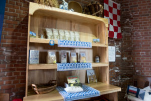 You can purchase local made cornmeal and flour at the DeZwaan Windmill in Holland, Michigan.