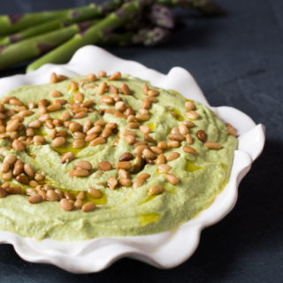 A spring inspired hummus recipe. Asparagus boosts the nutrition value of traditional hummus.