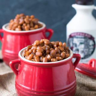 Maple Baked Beans are made in the slow cooker for an easy side dish. Perfect for your summer BBQs!