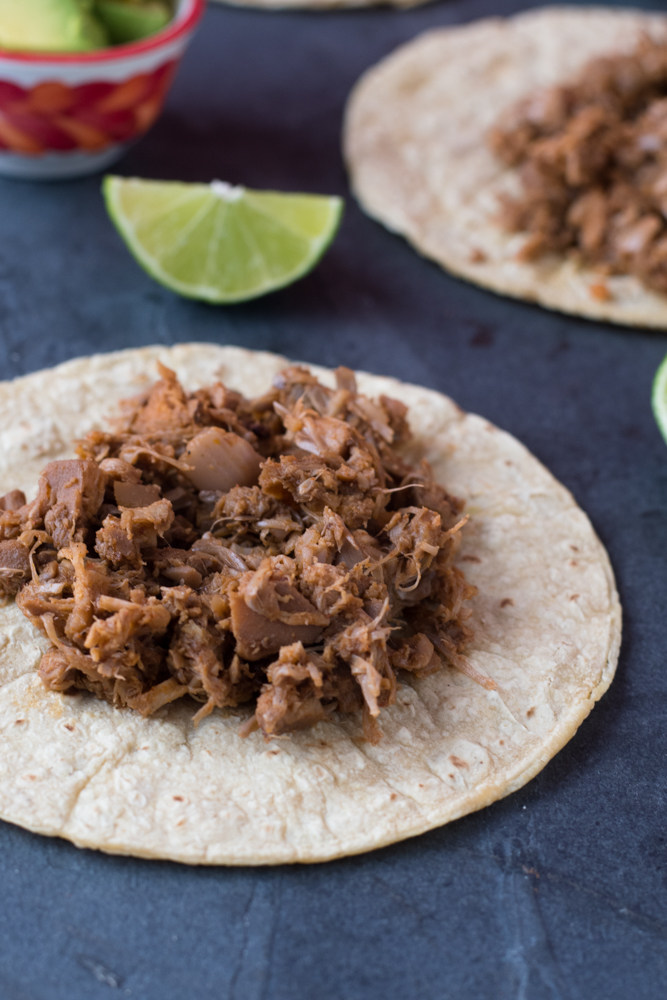 Jackfruit is cooked the slow cooker in Mexican beer. A flavorful and satisfying plant-based taco filling.