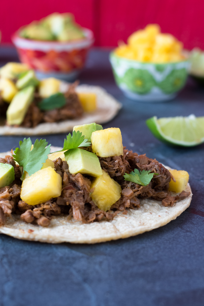 Jackfruit is braised in the slow cooker with a spice mix and cooked in beer. This jackfruit makes for a delicious vegan taco!