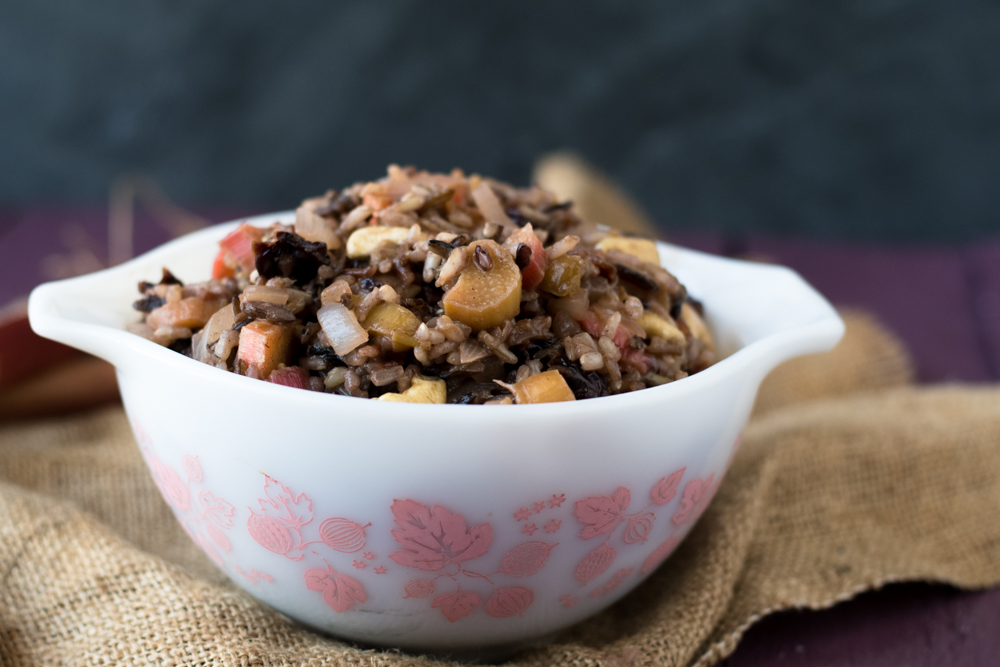Rhubarb Wild Rice Pilaf is layered with flavor. It's a little tart from the rhubarb and the wild rice is nutty. The pilaf is naturally sweetened with just a touch of maple syrup.