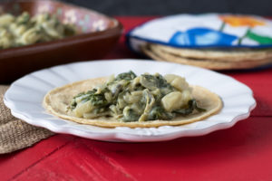 Spicy chile peppers and cream were just made for each other. These Creamy Braised Swiss Chard and Potato Tacos are a simple, satisfying taco that everyone will enjoy!