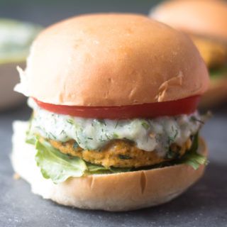 These Vegan Chickpea Burgers with Tzatziki Sauce are made with Middle Eastern spices and fresh herbs. They are quick and easy to make too!