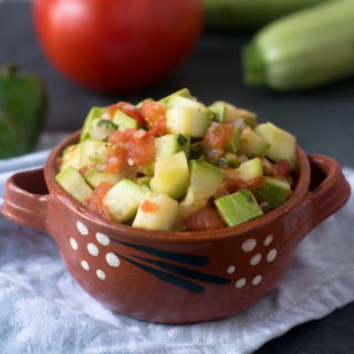 Calabacitas a la Mexicana makes a wonderful vegetable side dish for dinner. It also makes a delicious taco filling.