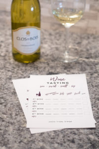 Tips on how to host a wine tasting at home! Plus download this free printable for your own wine tasting party!