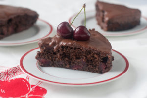 This chocolate cake is light, moist and airy. The perfect summertime cake. The secret to creating a light cake is beer!