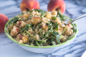This Peach Quinoa Salad with Sriracha Vinaigrette is an easy salad recipe. It is a little sweet from the peaches and a little spicy from the Sriracha vinaigrette.
