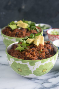 Slow Cooker Pumpkin Chili is perfect for fall! Quinoa and black beans add lots of protein to this vegan chili.