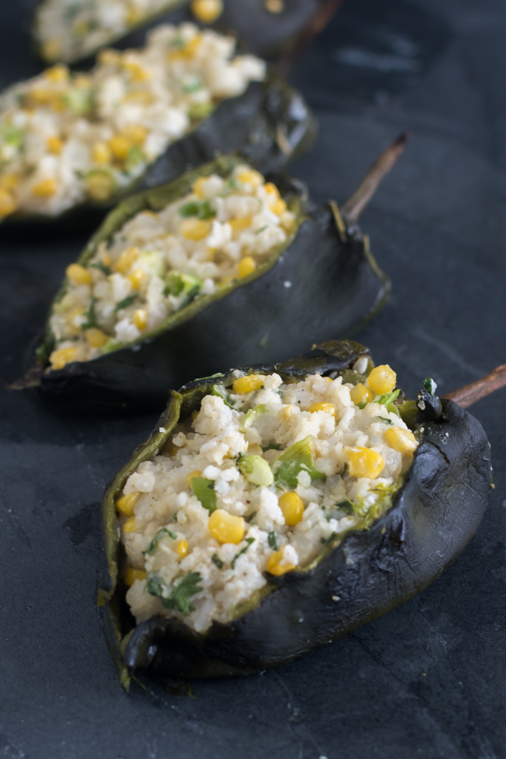 Roasted poblano peppers are stuffed with a creamy, rice filling. I like to serve these with an avocado and tomatillo salsa.