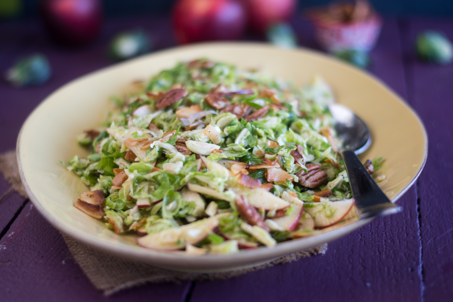 Brussel Sprout Apple Salad with coconut bacon is perfect for fall. The coconut bacon really takes this salad to the next level!