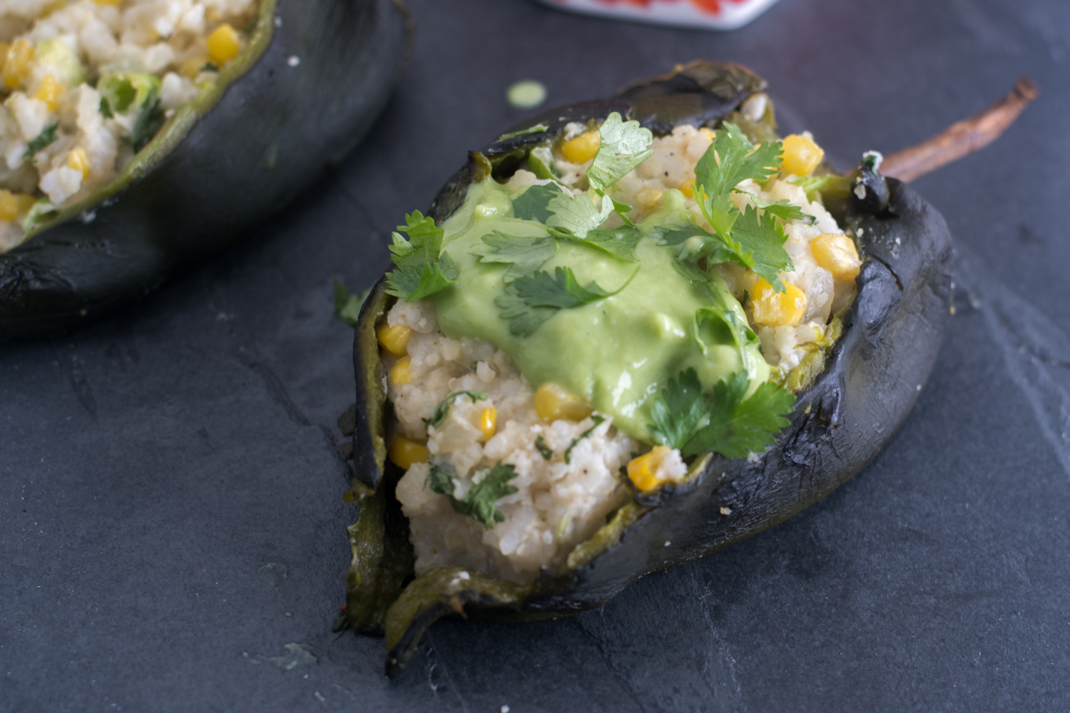 Roasted poblano peppers are stuffed with a creamy, rice filling. I like to serve these with an avocado and tomatillo salsa. #vegan #glutenfree