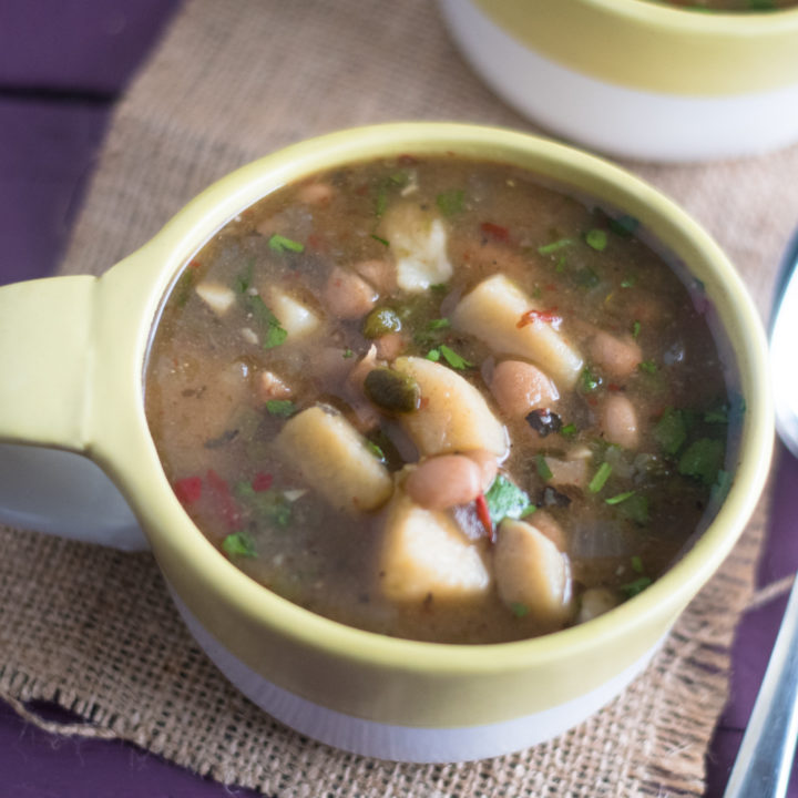 This Slow Cooker Mexican Bean and Potato Soup is perfect for a chilly, rainy day! Lots of spice from three types of peppers!