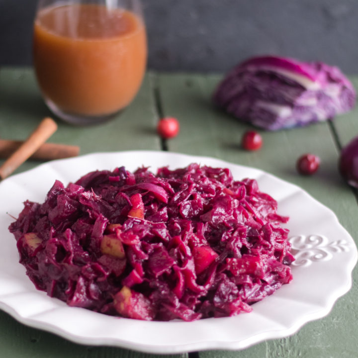 Add this festive Braised Red Cabbage with cranberries to your holiday table! #holidays