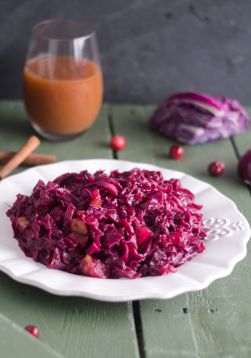 Add this festive Braised Red Cabbage with cranberries to your holiday table! #vegan #glutenfree