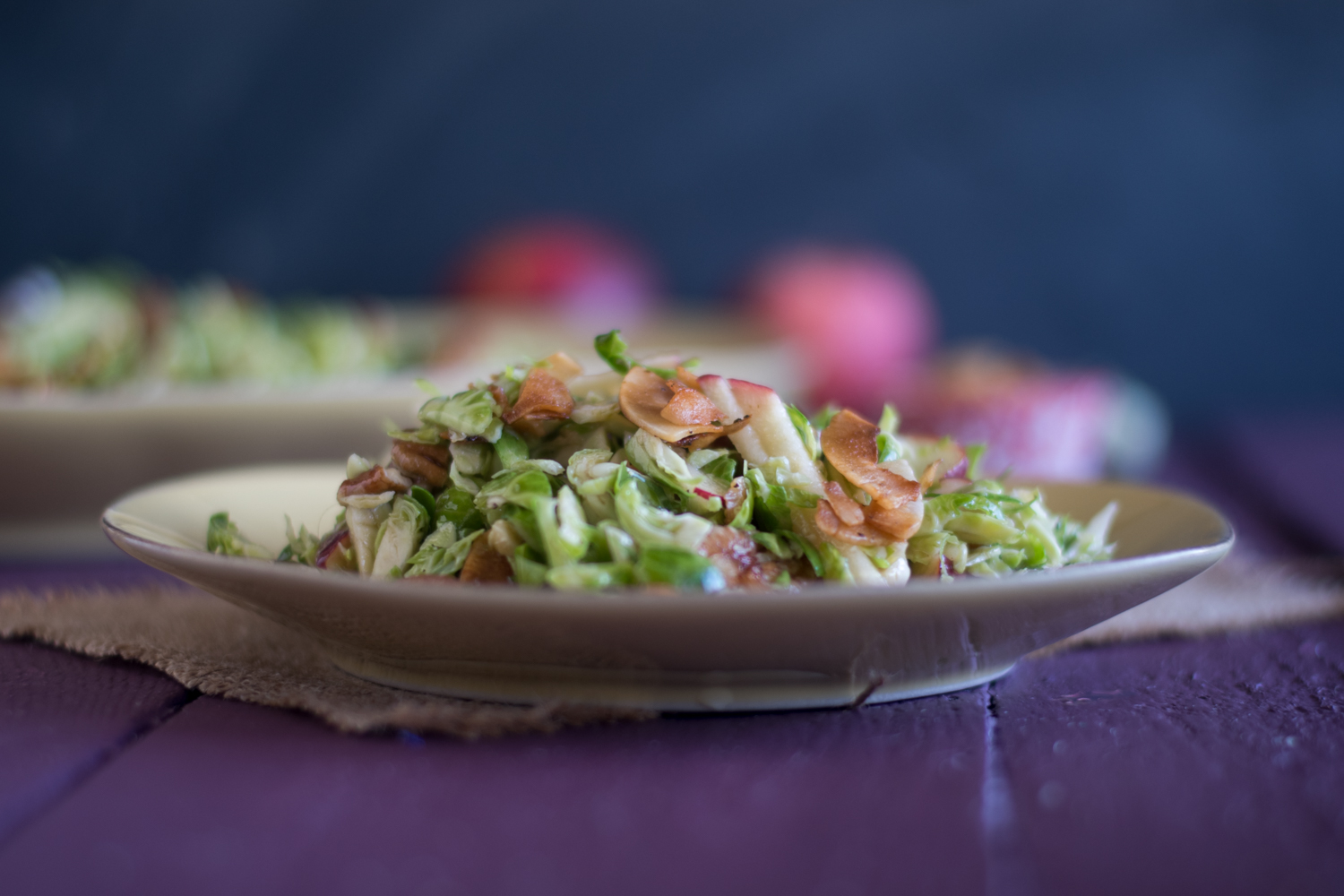 Brussel Spout Apple Salad with a maple dressing is perfect for fall. The coconut bacon takes this salad to the next level!