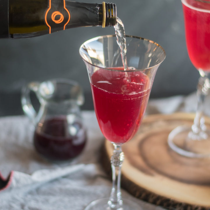 This Pomegranate Orange Prosecco Cocktail is light, refreshing and perfect for entertaining!