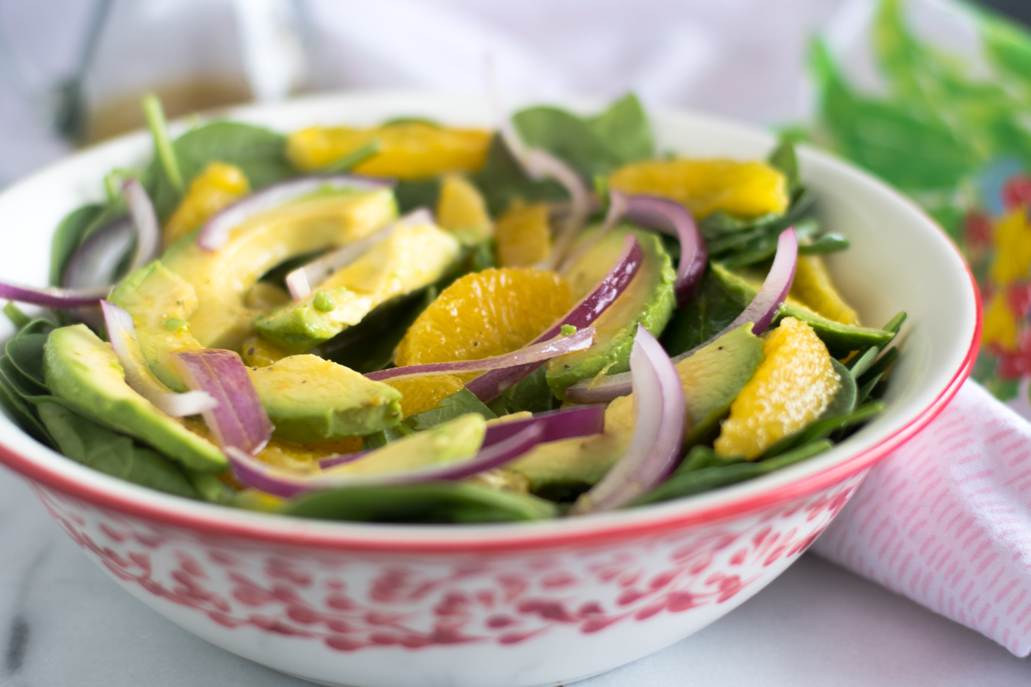 Start the new year off on a healthy note with this Spinach Orange and Avocado Salad with Guava Dressing! This salad is  light, refreshing and a perfect balance of flavors. #vegan #salad