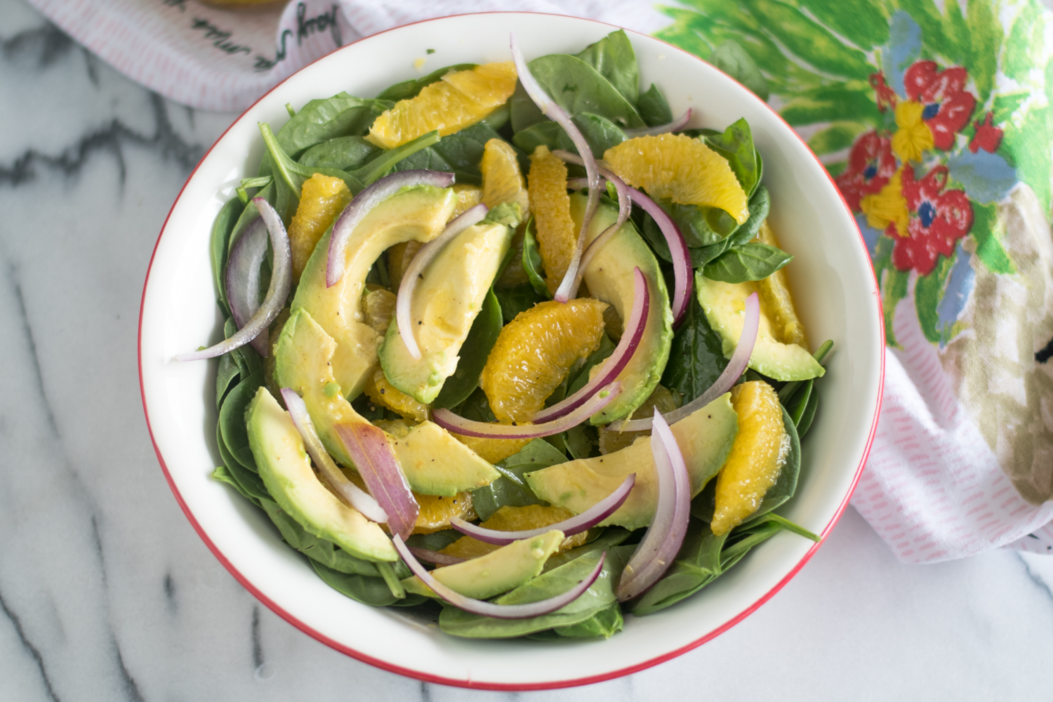 Light, refreshing Spinach Orange and Avocado Salad with a Guava Dressing. #vegan #salad #healthy