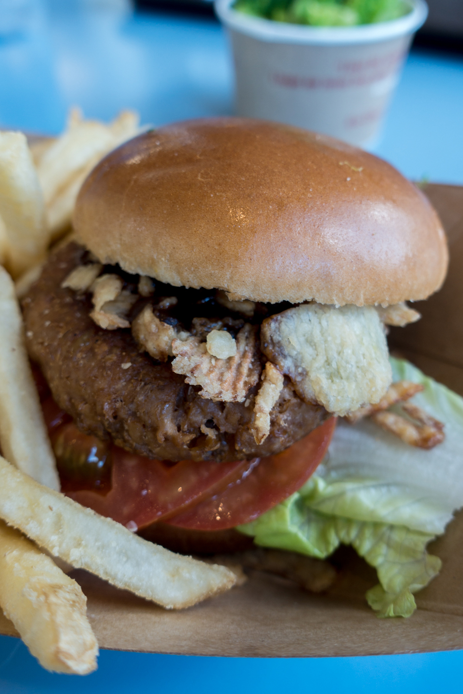 Grilled Vegetarian Burger at Liberty Inn located at the America Pavilion in Epcot. #vegan #vegandisney