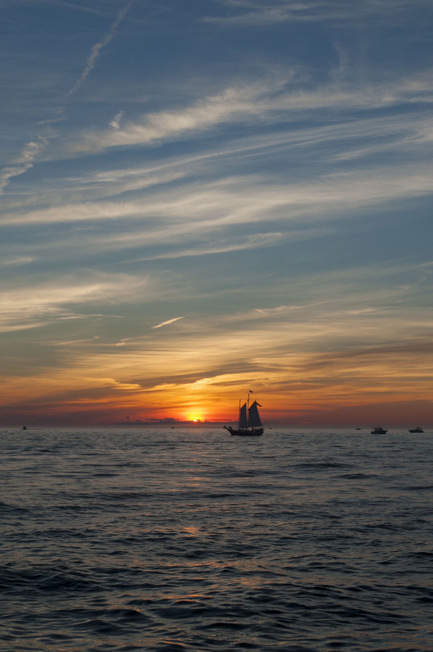 Watching the sunset along the pier is the perfect way to end your day in Grand Haven.