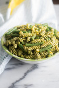 This Easy Vegan Pesto Pasta Salad is perfect for BBQs and potlucks! Use your favorite pesto recipe store-bought vegan pesto.