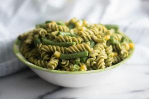 This Easy Vegan Pesto Pasta Salad is perfect for BBQs and potlucks! #vegan