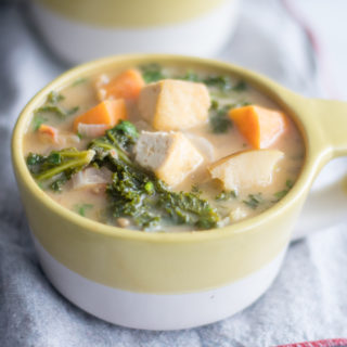 Tofu Sweet Potato and Almond Butter Stew with kale is a healthy and nutritious stew.  #vegan #stew