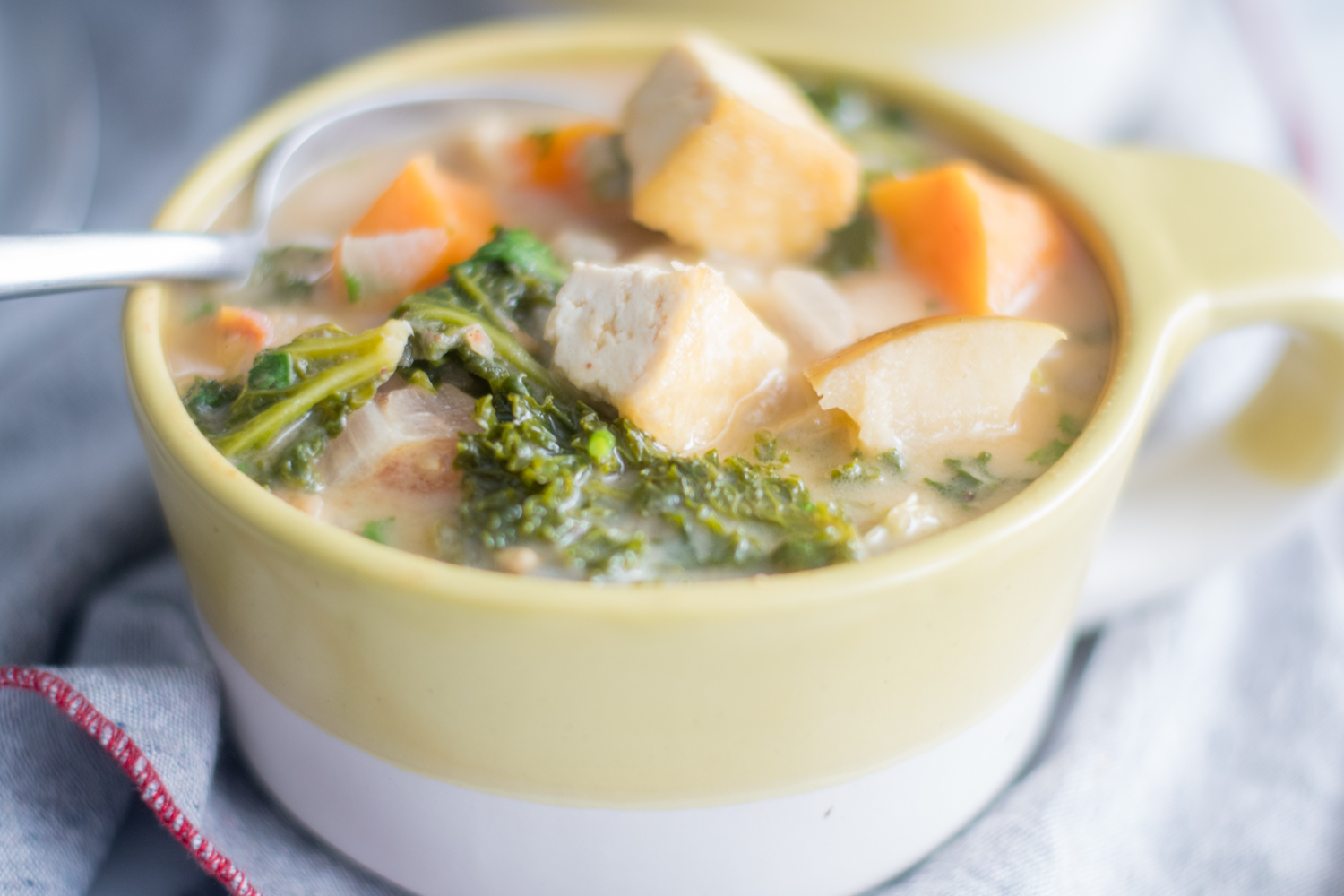 Tofu Sweet Potato and Almond Butter Stew with kale is a healthy and nutritious stew.#vegan #glutenfree