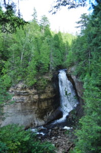 Pictured Rocks National Lakeshore is one of the most beautiful places in Michigan. Located in the Upper Peninsula, Pictured Rocks offers waterfalls, a gorgeous shoreline, miles of hiking trails, and beaches.