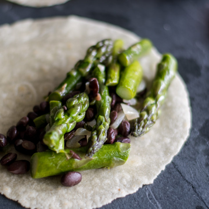 Easy Asparagus and Black Bean Tacos with avocado dip are the perfect taco for spring! #vegan #taco #asparagus #avocado #bean #glutenfree #dinner