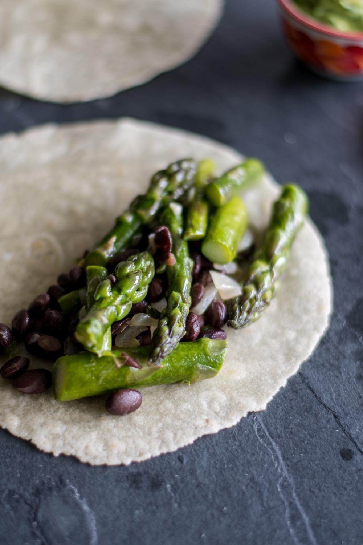 Easy Asparagus and Black Bean Tacos with avocado dip are the perfect taco for spring!#vegan #taco #asparagus #avocado #bean #glutenfree #dinner