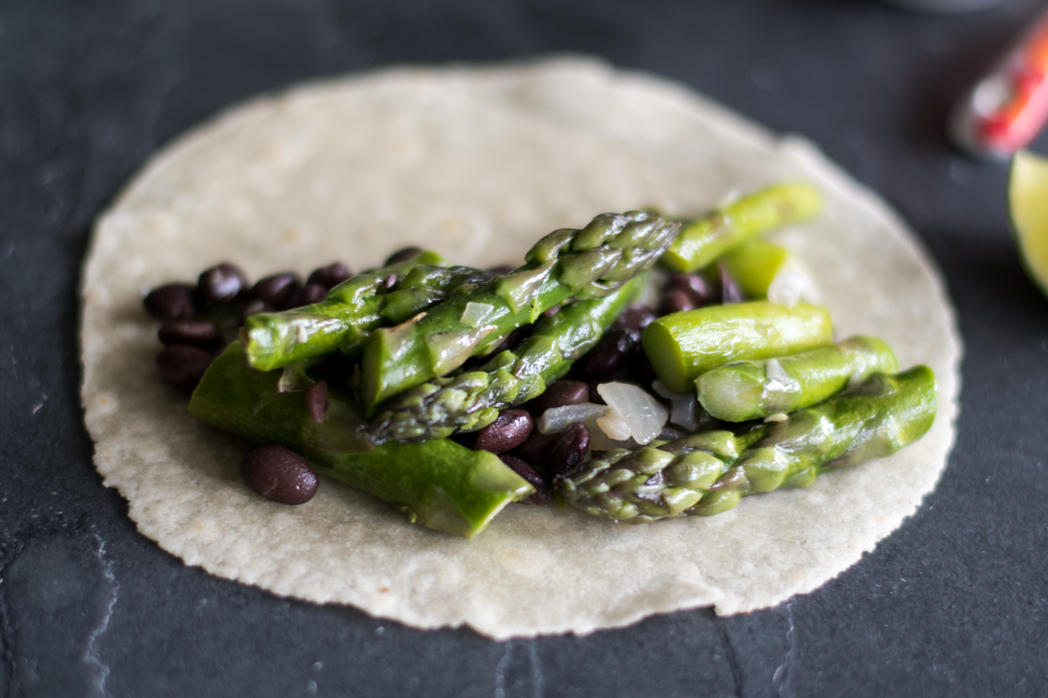 Easy Asparagus and Black Bean Tacos are the perfect taco for spring! #vegan #taco #asparagus #spring #glutenfree