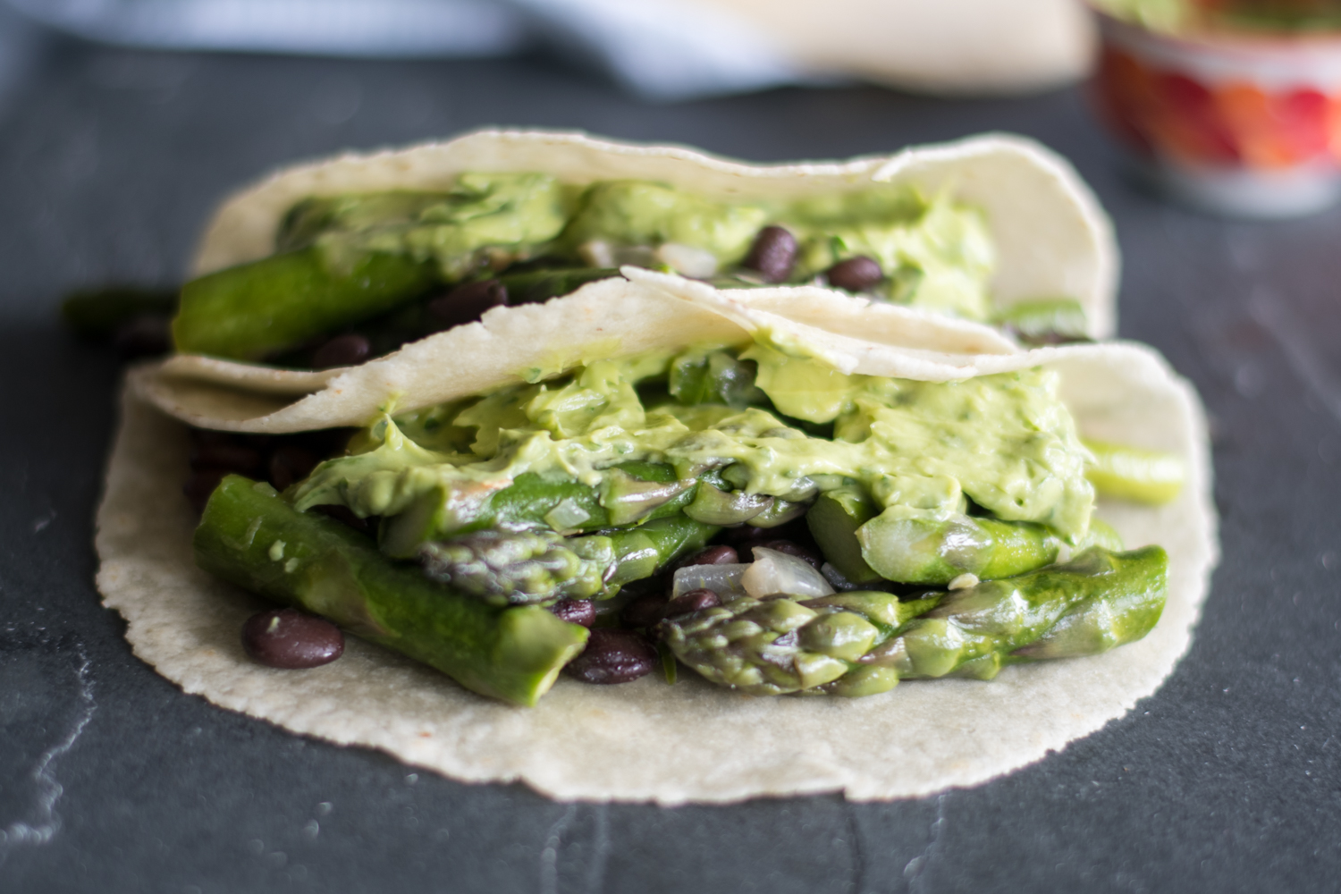 Easy Asparagus and Black Bean Tacos with avocado dip are perfect for spring! #vegan #tacos #spring #avocado #blackbean