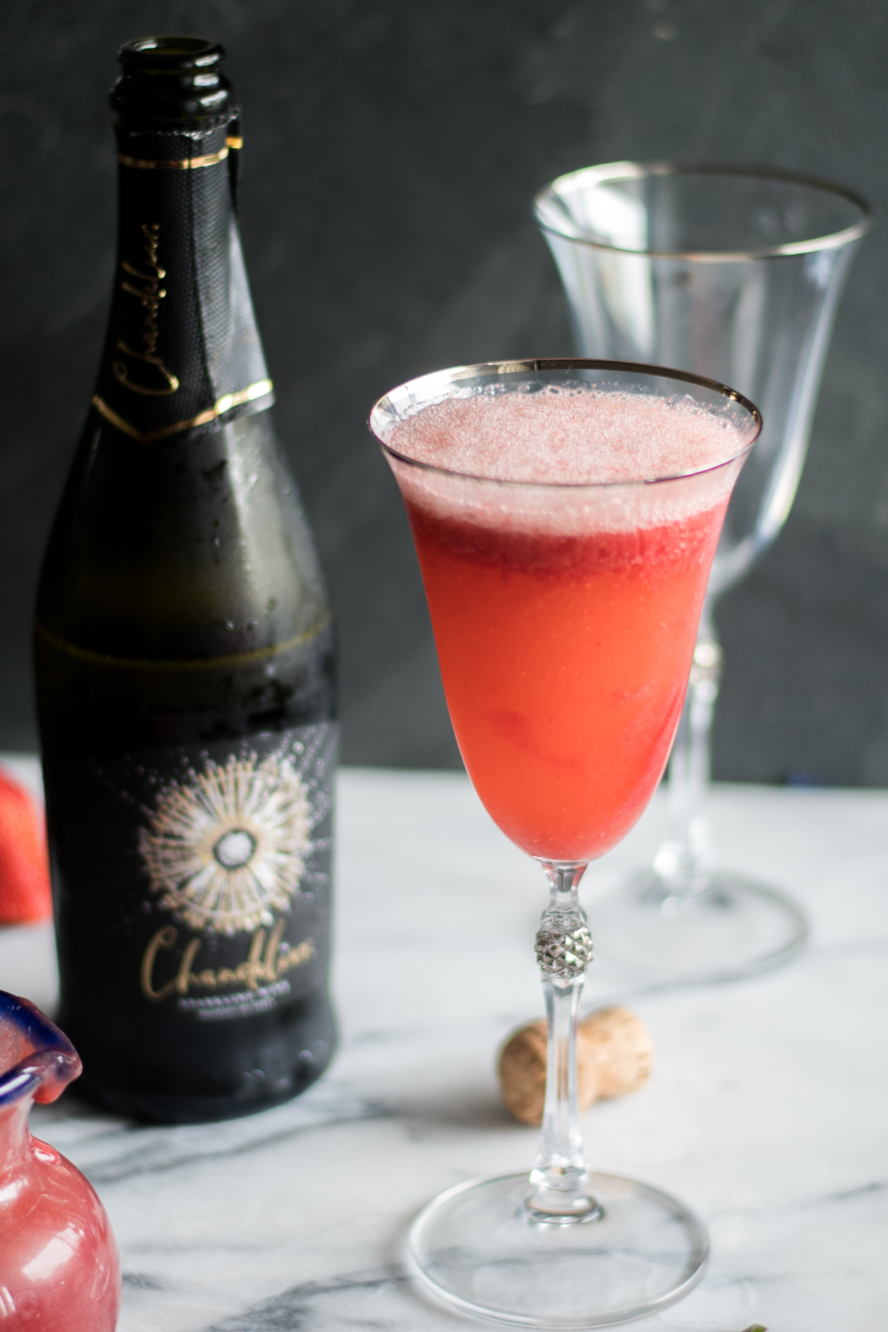 Strawberry Bellini is a twist on the classic peach bellini which is made with peach puree and sparkling wine. Instead of using peach puree, this cocktail uses a strawberry puree. #wine #summer #cocktail