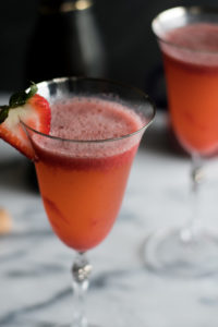 This Strawberry Bellini will be the hit at your next party! Whether it's a girl's night in or a summer backyard BBQ, this Strawberry Bellini will be the star of the party!