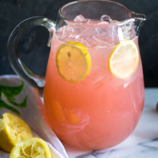 Light, refreshing lemonade made with rhubarb simple syrup. The perfect way too cool down on a hot summer day. #summer #recipe #rhubarb #lemonade #lemon #drink #vegan