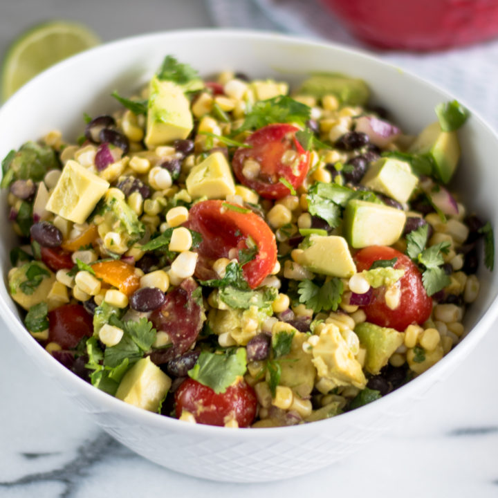 This Black Bean, Corn and Avocado Salad is perfect for summer! The hot sauce and cumin add a nice touch of flavor and heat to the salad. Perfect for potlucks! #summer #BBQ #Vegan #Glutenfree #Avocado #Salad