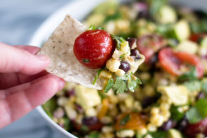 This Black Bean, Corn and Avocado Salad is perfect for summer! The hot sauce and cumin add a nice touch of flavor and heat to the salad. #Salad #Vegan #Recipe