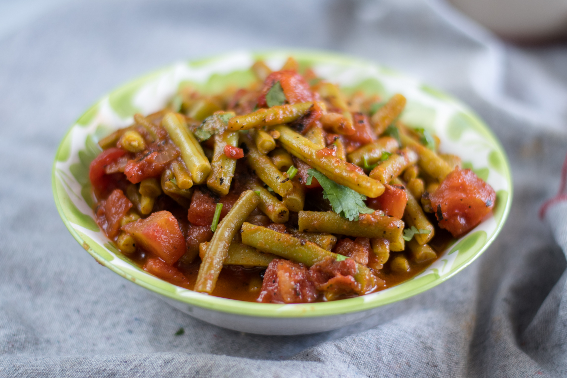 Chipotle green beans with tomatoes are a simple dish dish. Simple to make too! #vegan #beans #Mexican #summer #greenbeans