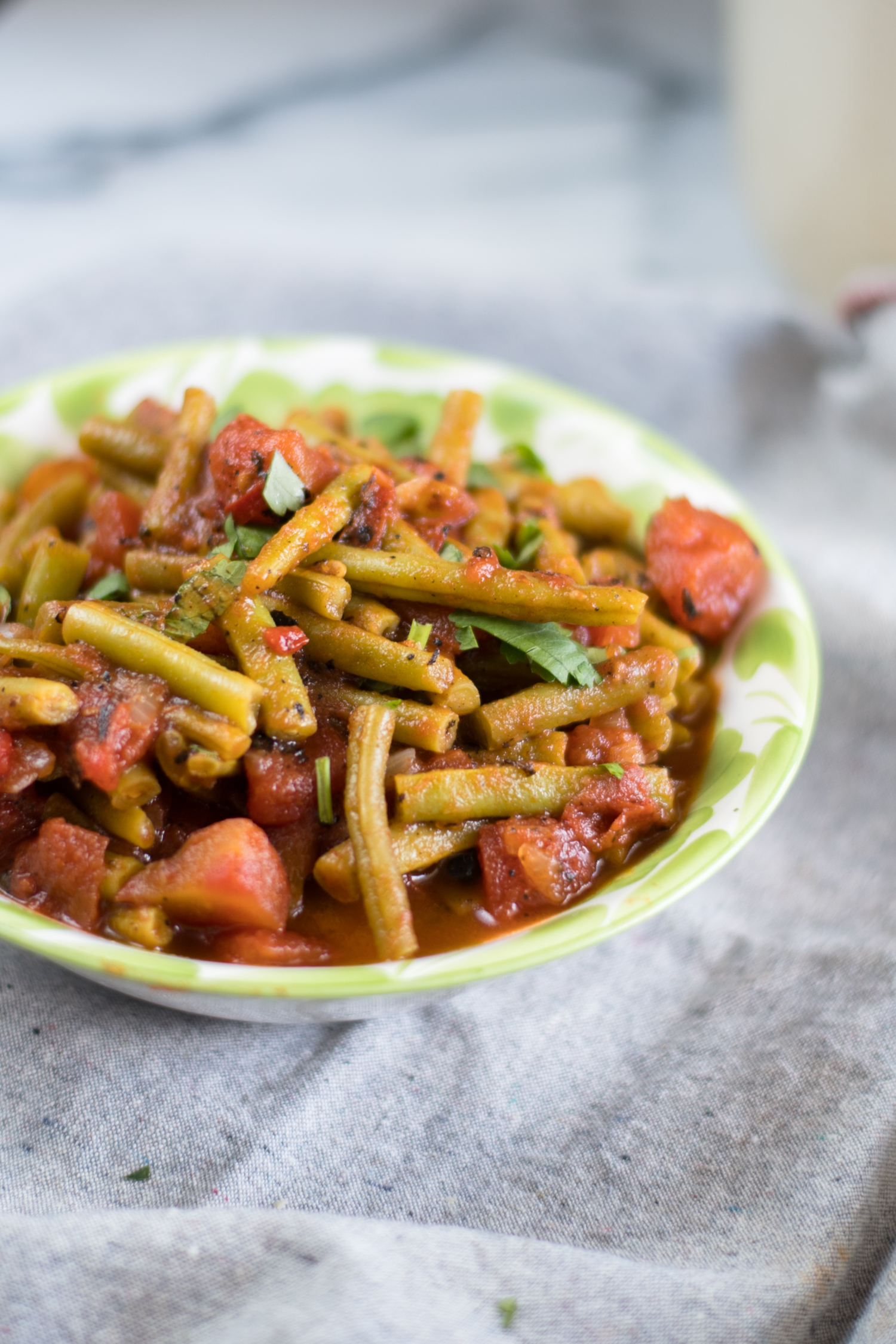 Green Beans simmered in a simple tomato and chipotle sauce. #Greenbeans #Recipe #summer #greenbeans #vegan #side