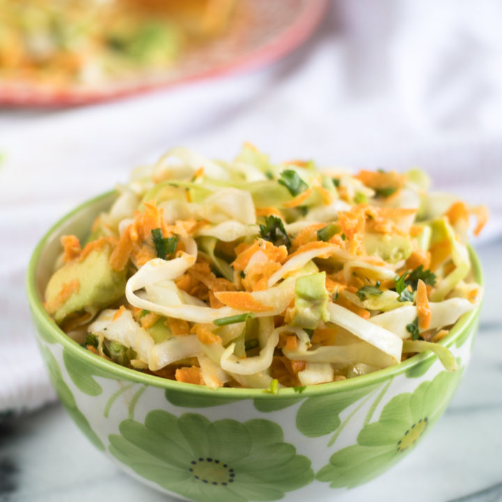This Mexican Cabbage and Avocado is the perfect side dish to your next taco night! #Vegan #Recipes #GlutenFree #Dairyfree #Mexican #side #Salad #healthyrecipes