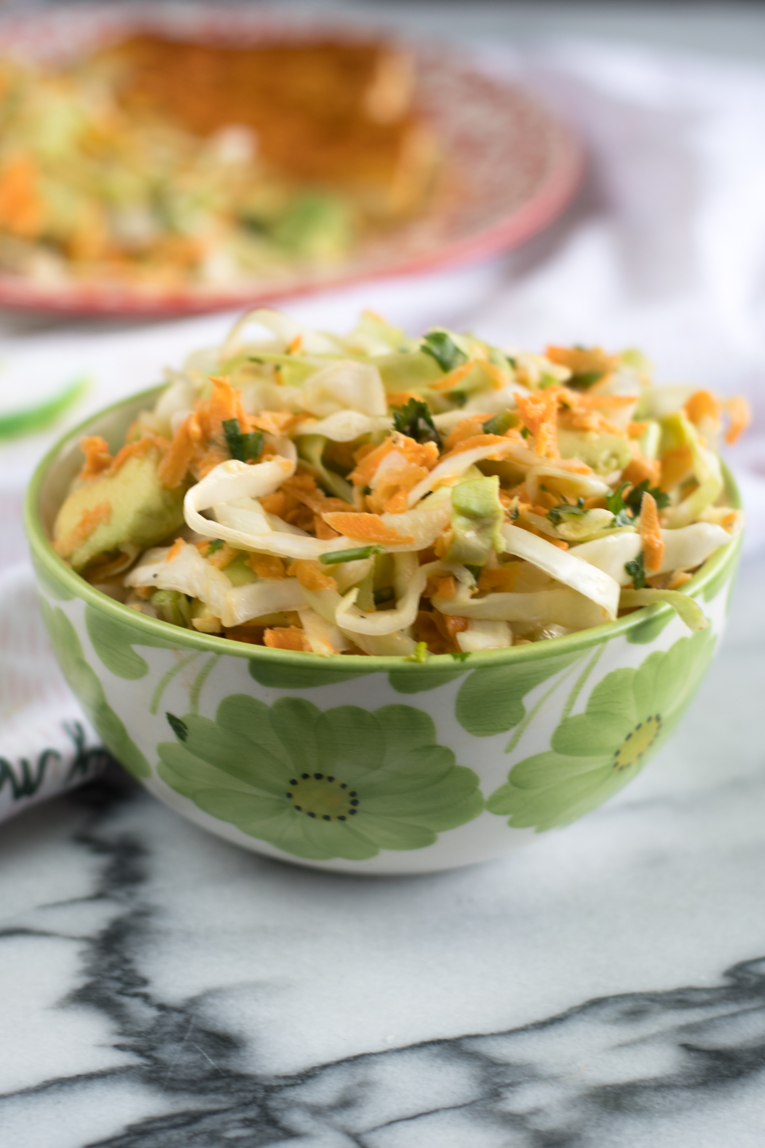 A flavorful cabbage and avocado salad. Naturally Vegan & GlutenFree!