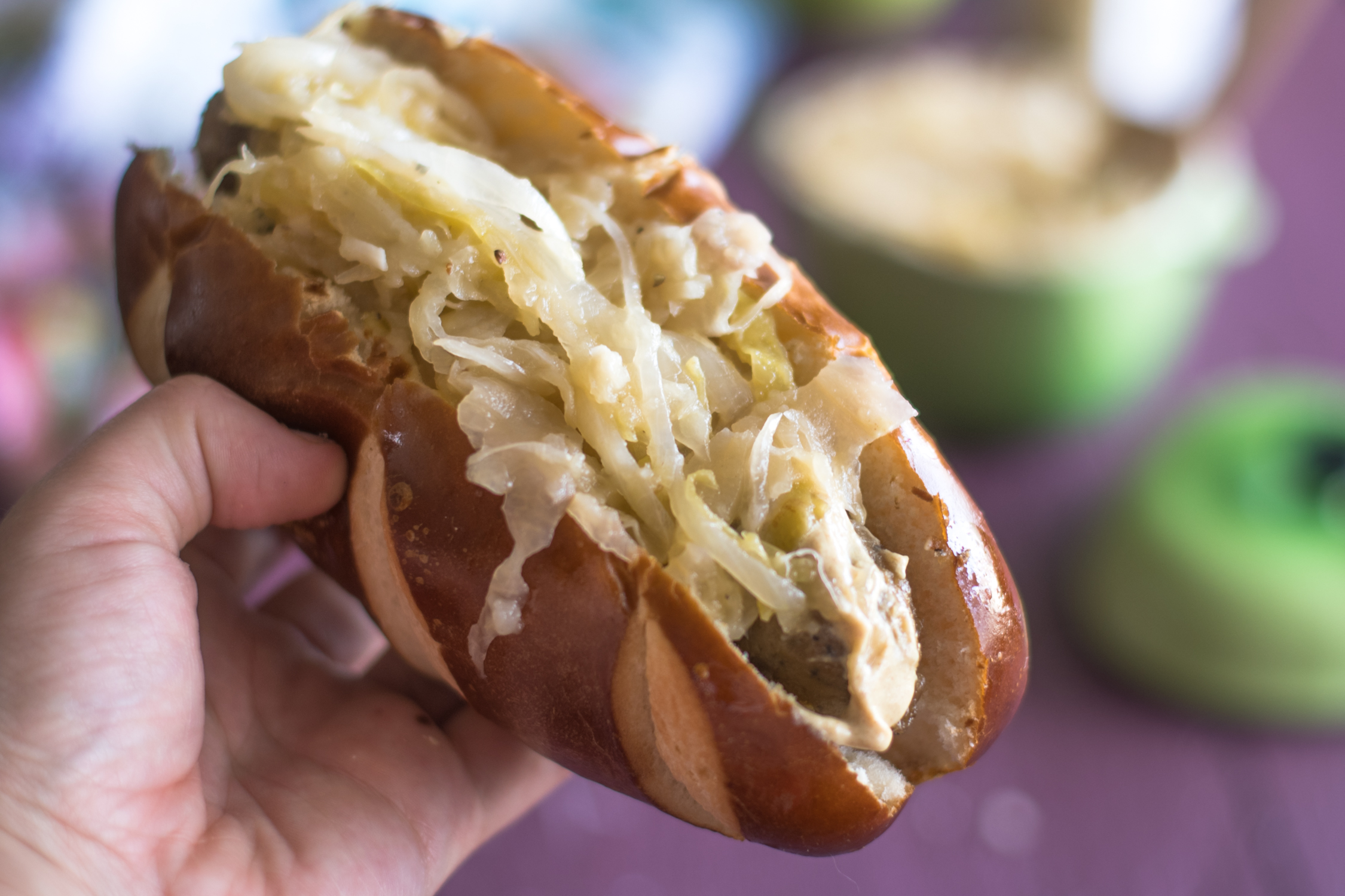 These Vegan dogs feature Field Roast's Smoked Apple and Sage Sausages are topped with an apple and sauerkraut topping!