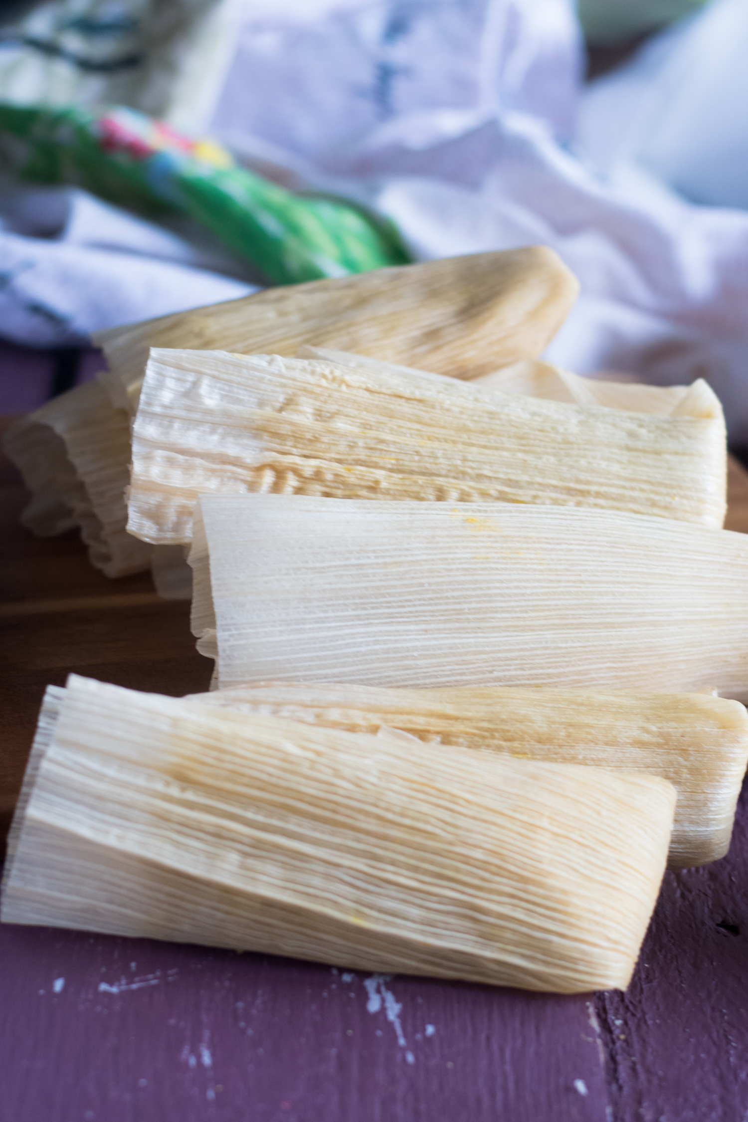 Fall inspired Mexican tamales filled with butternut squash and black beans. I like serving these tamales with a red chile sauce and cashew crema. #vegan #Mexican #Tamales