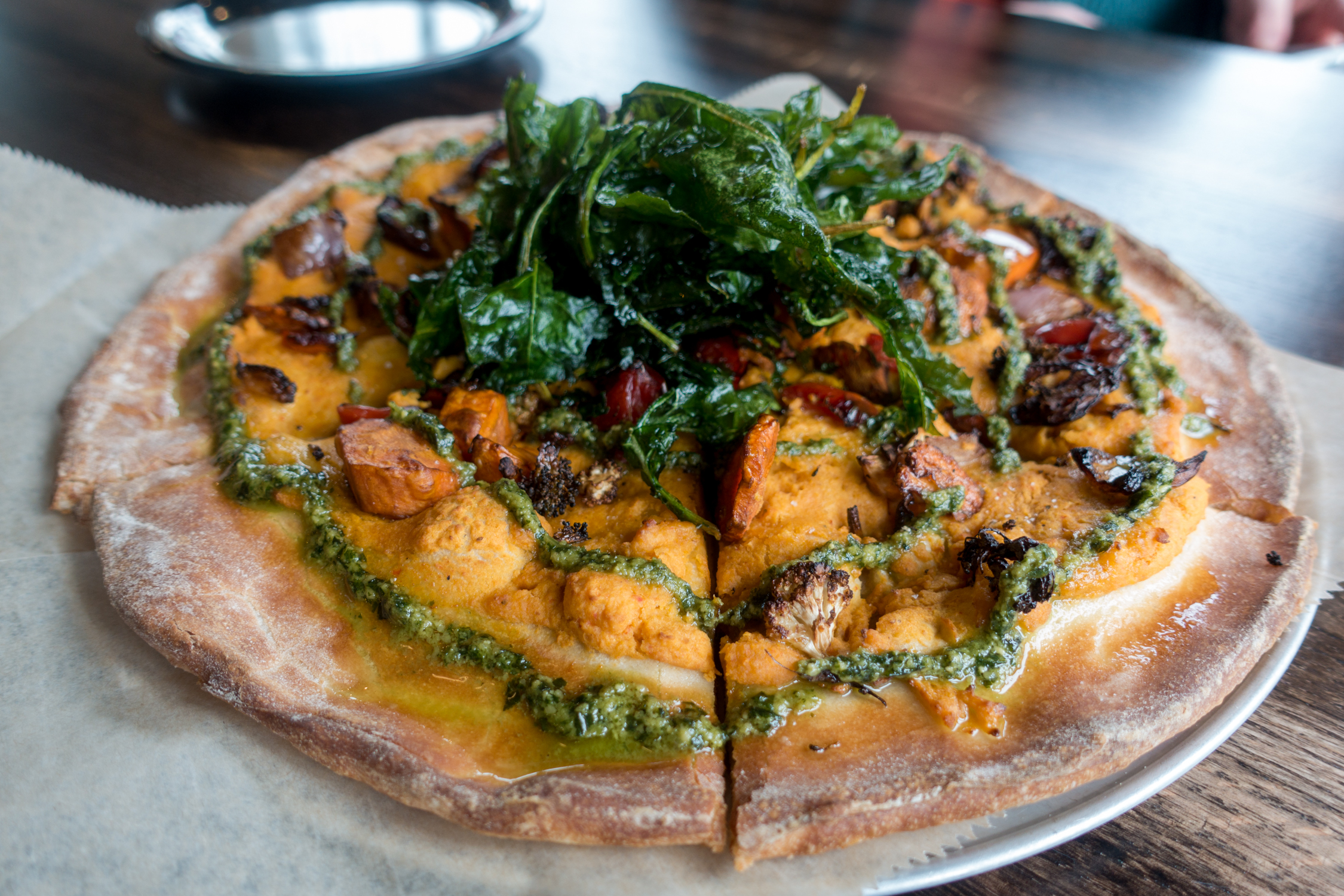 Whether you live in Grand Rapids or our planning a trip to this great Midwest city, I hope that this list of the Best Places for Vegan Pizza In Grand Rapids is helpful in your quest to find delicious vegan pizza! #vegan #travel #pizza #grandrapids